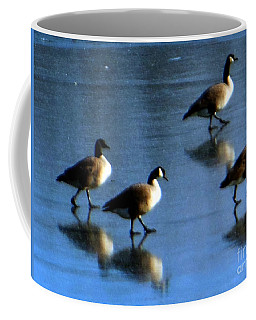 Coffee Mug featuring the photograph Four Geese Walking On Ice by Rockin Docks Deluxephotos