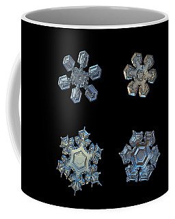 Coffee Mug featuring the photograph Four Snowflakes On Black 2 by Alexey Kljatov