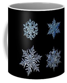 Four Snowflakes On Black Background Coffee Mug