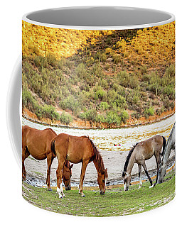 Four Wild Horses Grazing Along Arizona River Coffee Mug