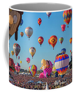 Coffee Mug featuring the photograph Funky Balloons by Tom Singleton