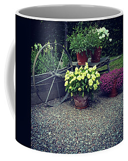 Garden Decorated With Flowers And Old Wheel Coffee Mug