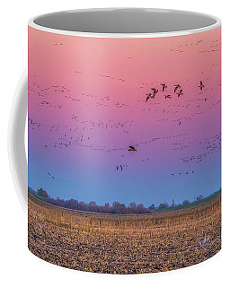 Geese Flying At Sunset Coffee Mug by Marc Crumpler