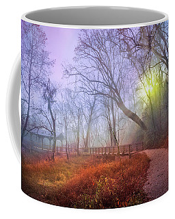 Coffee Mug featuring the photograph Glowing Through The Trees by Debra and Dave Vanderlaan
