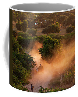 Coffee Mug featuring the photograph Going Home At Sunset by Pradeep Raja Prints