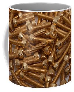 Coffee Mug featuring the photograph Gold Plated Screws by Gunter Nezhoda