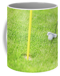 Golf Ball And Club Before Hitting Close Up. Coffee Mug