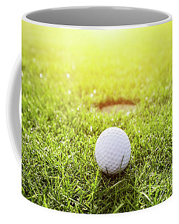 Golf Ball On A Grass. Sunshine Coffee Mug
