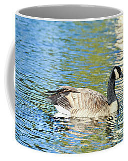 Coffee Mug featuring the photograph Goose And Sun Reflections by David Lawson