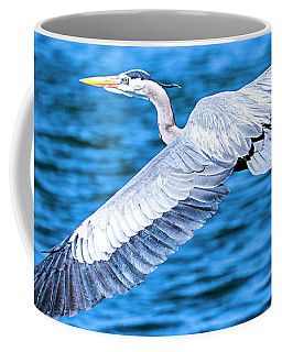 Coffee Mug featuring the photograph Great Blue Heron Flight by David Millenheft