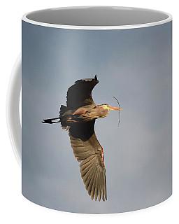 Coffee Mug featuring the photograph Great Blue Heron In Flight by Ann Bridges