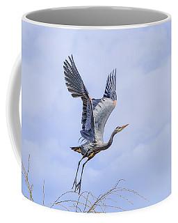 Great Blue Heron In Flight Coffee Mug by Keith Boone