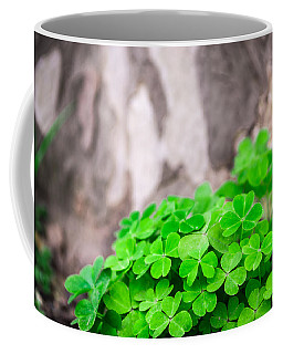 Green Clover And Grey Tree Coffee Mug by John Williams
