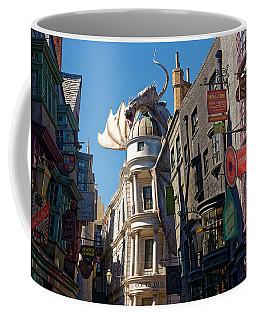 Coffee Mug featuring the photograph Gringotts Bank Dragon by Paul Mashburn