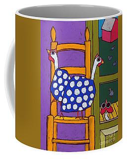 Guinea In The Chair Coffee Mug