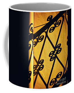 Coffee Mug featuring the photograph Gutter And Ornate Shadows by Silvia Ganora