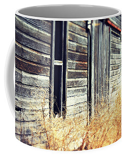 Coffee Mug featuring the photograph Hanging By A Bolt by Julie Hamilton