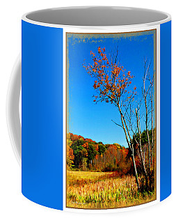 Coffee Mug featuring the photograph Hanging On To Autumn by Joan  Minchak