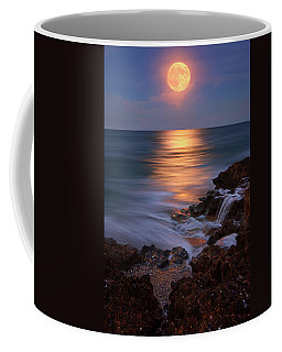 Coffee Mug featuring the photograph Harvest Moon Rising Over Beach Rocks On Hutchinson Island Florida During Twilight. by Justin Kelefas