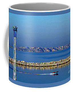 Coffee Mug featuring the photograph Heading Out To Sea At Dawn by Sue Melvin