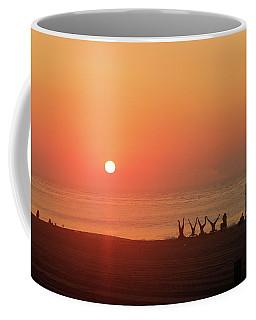 Coffee Mug featuring the photograph Headstand Fun At Sunrise by Robert Banach