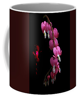 Coffee Mug featuring the photograph Hearts In The Dark by Susan Capuano