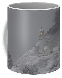 Coffee Mug featuring the photograph Heceta Lighthouse Snowstorm by Kenny Henson