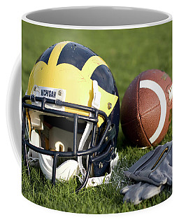 Helmet On The Field With Football And Gloves Coffee Mug