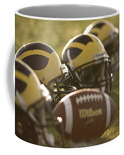 Helmets And A Football On The Field At Dawn Coffee Mug
