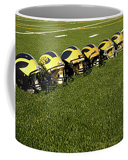 Helmets Of Different Eras On The Field Coffee Mug