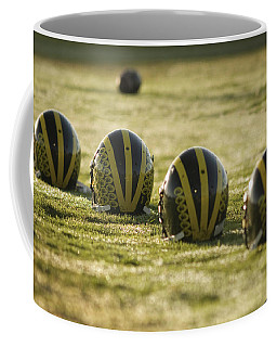 Helmets On Dew-covered Field At Dawn Coffee Mug