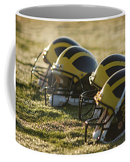 Helmets On The Field At Dawn Coffee Mug