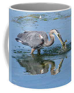 Great Blue Heron Catches A Fish Coffee Mug by Keith Boone