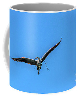Coffee Mug featuring the photograph Heron Flight by Kate Brown