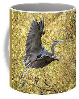 Heron In Flight Coffee Mug by Keith Boone