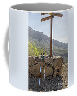 Hiking Poles Resting Near Sign Coffee Mug