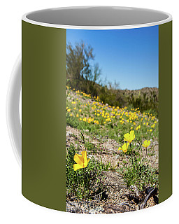 Coffee Mug featuring the photograph Hillside Flowers by Ed Cilley