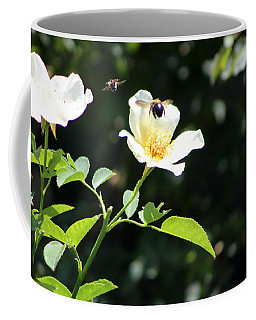 Honey Bees In Flight Over White Rose Coffee Mug