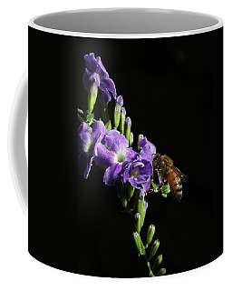 Coffee Mug featuring the photograph Honeybee On Golden Dewdrop by Richard Rizzo