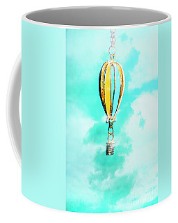Hot Air Balloon Pendant Over Cloudy Background Coffee Mug