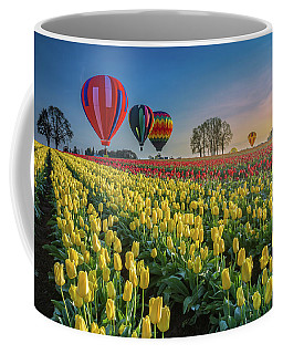 Coffee Mug featuring the photograph Hot Air Balloons Over Tulip Fields by William Lee
