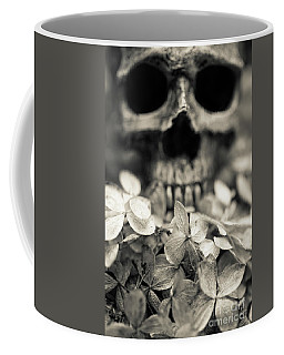Coffee Mug featuring the photograph Human Skull Among Flowers by Edward Fielding