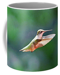 Coffee Mug featuring the photograph Hummingbird Flying by Meta Gatschenberger