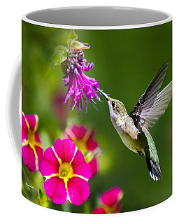 Coffee Mug featuring the photograph Hummingbird With Flower by Christina Rollo