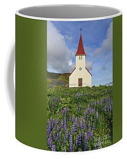 Coffee Mug featuring the photograph Icelandic Church Among The Fields Of Lupine by Edward Fielding
