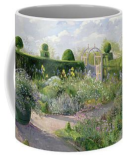 Irises In The Herb Garden Coffee Mug