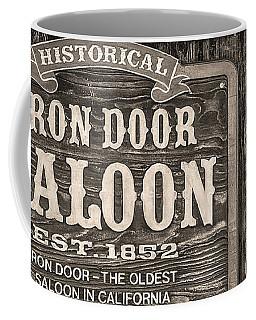 Coffee Mug featuring the photograph Iron Door Saloon 1852 by David Millenheft