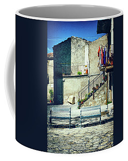 Coffee Mug featuring the photograph Italian Square With Benches by Silvia Ganora
