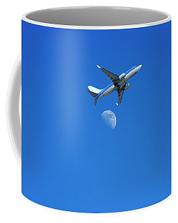 Jet Plane Flying Over The Moon Coffee Mug