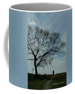 Jogger Runs Along A Path Past A Weeping Coffee Mug
